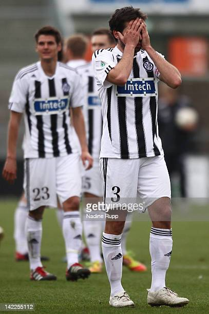 Leandro Grech and Andreas Hofmann of Aalen look dejected after loosing the Third League match between VfR Aalen and Chemnitzer FC at Scholz-Arena on...