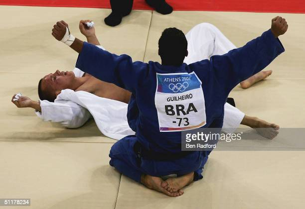 Leandro Guilheiro of Brazil celebrates victory over Victor Bivol of Moldova in the men's judo 73 kg class bronze medal contest on August 16 2004...