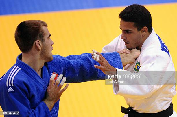 Leandro Gulheiro of Brazil and of Antoine Valios of Canada during the Judo men's 81kg of the 2011 XVI Pan American Games at the Gym Code II on...