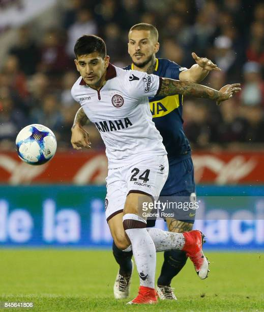 Leandro Maciel of Lanus fights for the ball with Dario Benedetto of Boca Juniors during a match between Lanus and Boca Juniors as part of the...