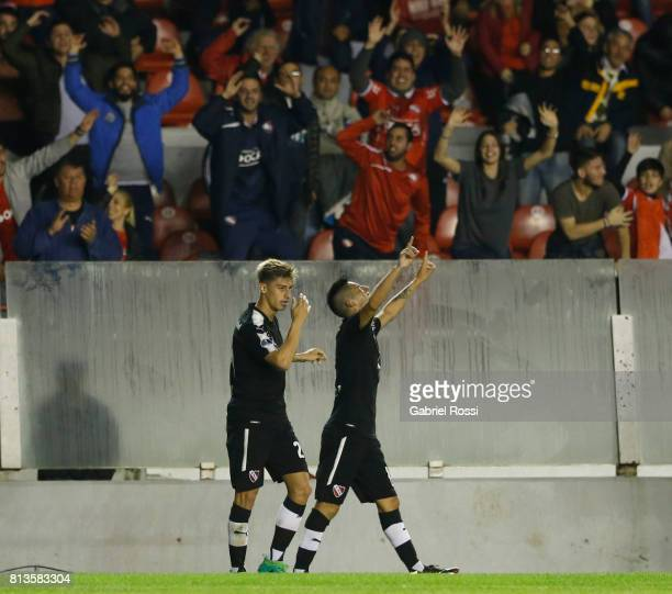 Leandro Miguel Fernandez of Independiente celebrates with teammates after scoring the third goal of his team during the first leg match between...