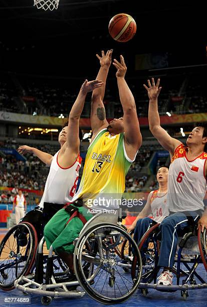 Leandro Mirando of Brazil shoots the ball in the Wheelchair Basketball match between the China and Brazil at the National Indoor Stadium during day...