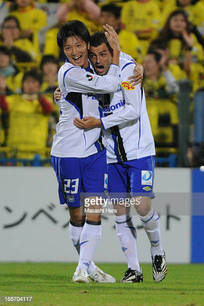Leandro of Gamba Osaka celebrates the first goal with Takuya Takei during the JLeague match between Kashiwa Reysol and Gamba Osaka at Hitachi Kashiwa...
