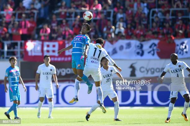 Leandro of Kashima Antlers and Akito Fukuta of Sagan Tosu compete for the ball during the JLeague J1 match between Sagan Tosu and Kashima Antlers at...