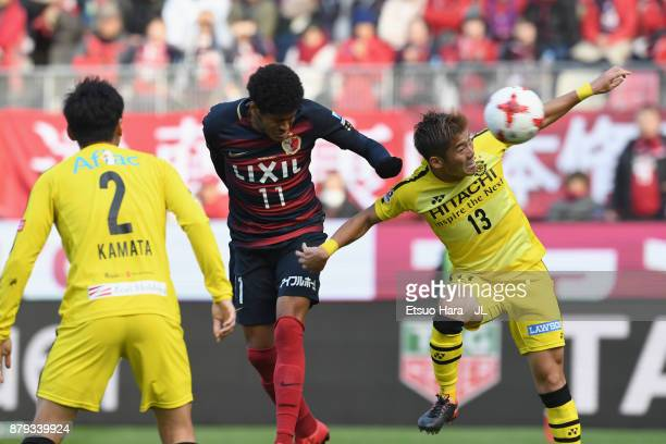 Leandro of Kashima Antlers and Ryuta Koike of Kashiwa Reysol compete for the ball during the JLeague J1 match between Kashima Antlers and Kashiwa...