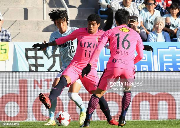 Leandro of Kashima Antlers and Shunsuke Nakamura of Jubilo Iwata compete for the ball during the JLeague J1 match between Jubilo Iwata and Kashima...