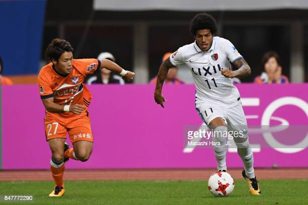 Leandro of Kashima Antlers and Yuto Horigome of Albirex Niigata compete for the ball during the JLeague J1 match between Albirex Niigata and Kashima...