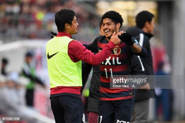 Leandro of Kashima Antlers celebrates scoring the opening goal with his team mate Mitsuo Ogasawara during the JLeague J1 match between Kashima...