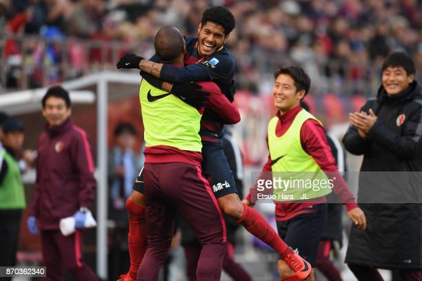Leandro of Kashima Antlers celebrates scoring the opening goal with his team mates and staffs during the JLeague J1 match between Kashima Antlers and...