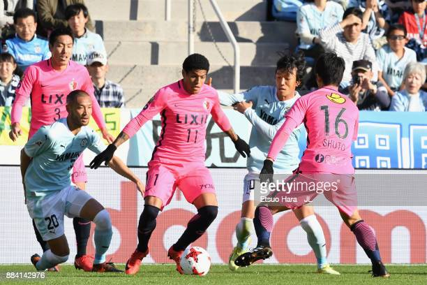 Leandro of Kashima Antlers controls the ball under pressure of Shunsuke Nakamura and Kengo Kawamata of Jubilo Iwata during the JLeague J1 match...