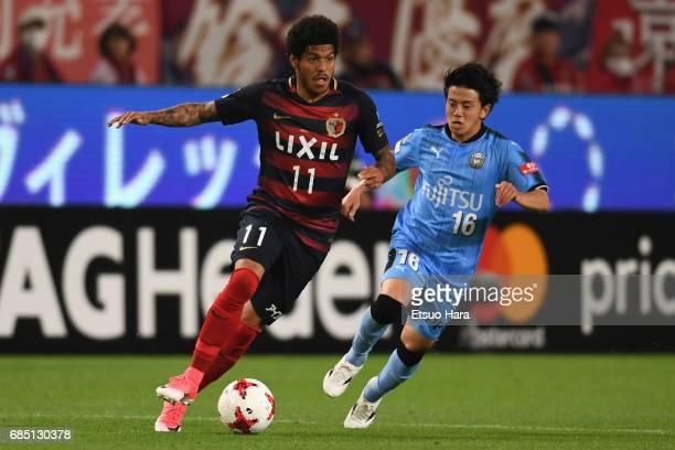 Leandro of Kashima Antlers controls the ball under pressure of Tatsuya Hasegawa of Kawasaki Frontale during the J.League J1 match between Kashima...