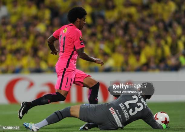 Leandro of Kashima Antlers goes past Kosuke Nakamura of Kashiwa Reysol during the J.League J1 match between Kashiwa Reysol and Kashima Antlers at...