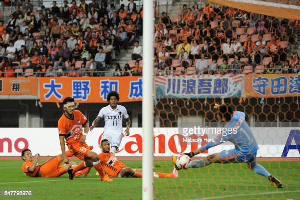 Leandro of Kashima Antlers scores his side's third goal past Koki Otani of Albirex Niigata during the JLeague J1 match between Albirex Niigata and...