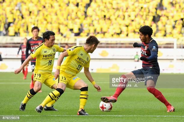 Leandro of Kashima Antlers takes on Ryuta Koike and Hiroto Nakagawa of Kashiwa Reysol during the JLeague J1 match between Kashima Antlers and Kashiwa...
