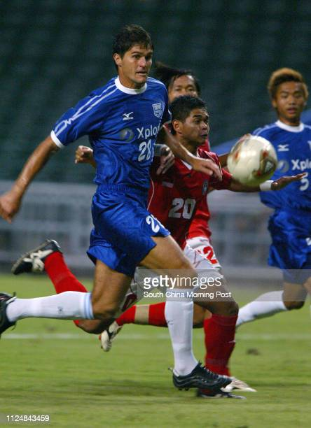 Leandro of Kitchee tackles Bambang Pamungkas in the match Kitchee vs Indonesia in Hong Kong Stadium 13 July 2004