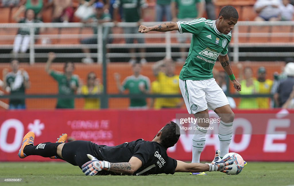Leandro (R) of Palmeiras fights for the ball with goalkeeper Douglas of Boa Esporte during the match between Palmeiras and Boa Esporte for the Brazilian Championship Series B 2013 at Pacaembu Stadium on November 16, 2013 in Sao Paulo, Brazil.