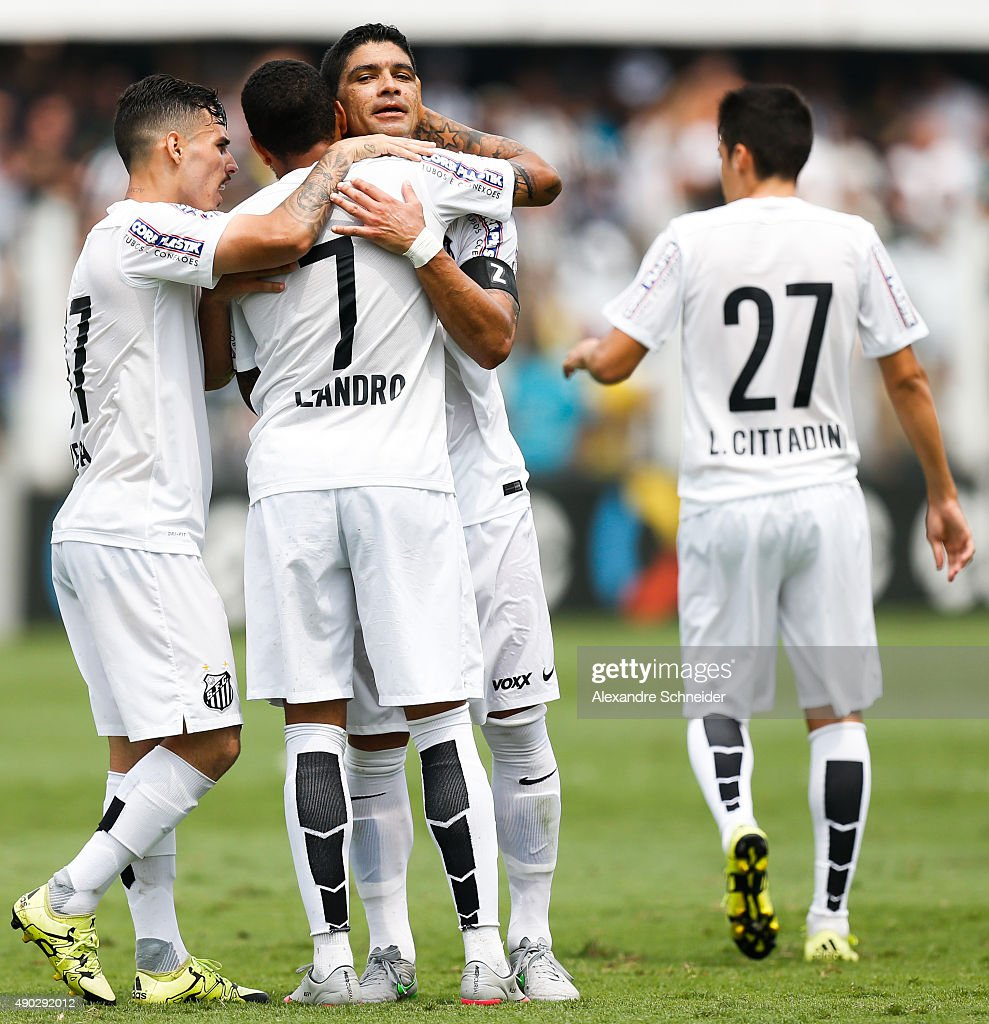 Leandro #07 of Santos celebrates their thirth goal with his teammates during the match between Santos and Internacional for the Brazilian Series A 2015 at Vila Belmiro stadium on September 27, 2015 in Santos, Brazil.