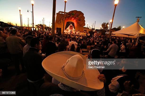 LOS ANGELES CALIFORNIA NOVEMBER 26 2014 Leandro Orozco of Mariachi Estrellas Tapatias adjusts his sombrero as he listens to music during the festival...