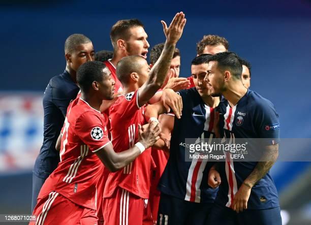 Leandro Paredes and Angel Di Maria of Paris Saint-Germain clash with Thiago Alcantara of FC Bayern Munich and David Alaba of FC Bayern Munich during...