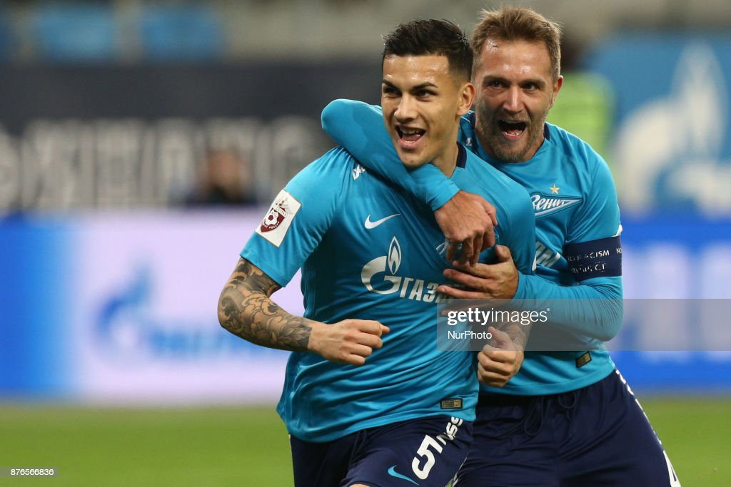 Leandro Paredes (L) and Domenico Criscito of FC Zenit Saint Petersburg celebrates after scoring a goal during the Russian Football League match between FC Zenit Saint Petersburg and FC Tosno at Saint Petersburg Stadium on November 19, 2017 in St. Petersburg, Russia.