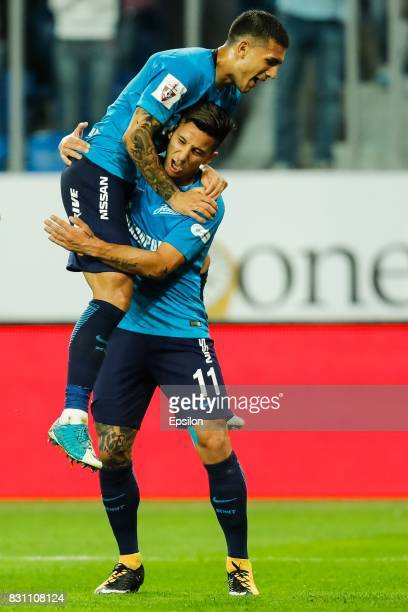 Leandro Paredes and Sebastian Driussi of FC Zenit Saint Petersburg celebrate a goal during the Russian Football League match between FC Zenit St...