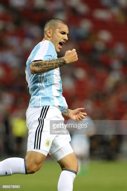 Leandro Paredes celebrates scoring the fourth goal for Argentina during the international friendly match between Argentina and Singapore at National...