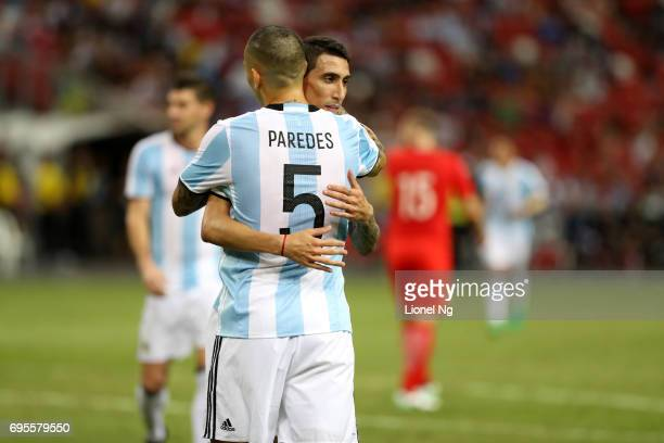 Leandro Paredes celebrates with Angel Di Maria of Argentina after scoring the fourth goal during the international friendly match between Argentina...