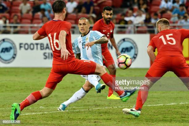Leandro Paredes of Argentina attempts a shot on goal against Singaporeteam during their International friendly football match at the national...
