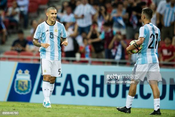 Leandro Paredes of Argentina celebrates a score with Paulo Dybala during the International Test match between Argentina and Singapore at National...
