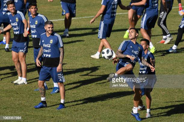 Leandro Paredes of Argentina controls the ball as teammates Mauro Icardi looks on during a training session ahead of the international friendly match...