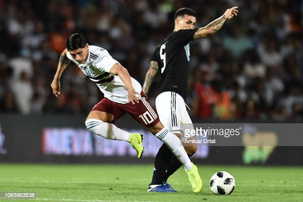 Leandro Paredes of Argentina fights for the ball with Alan Pulido of Mexico during a friendly match between Argentina and Mexico at Malvinas...