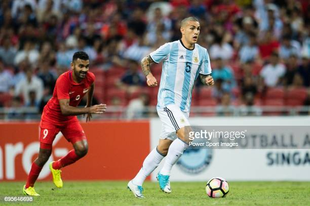 Leandro Paredes of Argentina in action against Faritz Hameed of Singapore during the International Test match between Argentina and Singapore at...