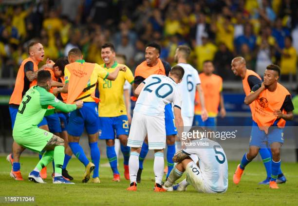 Leandro Paredes of Argentina reacts as players of Brazil celebrate after winning the Copa America Brazil 2019 Semi Final match between Brazil and...