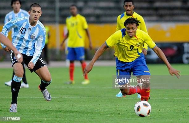Leandro Paredes of Argentina struggles for the ball with Luis Batioja of Ecuador during a match as part of the 2011 Sudamericano Sub 17 Cup match at...