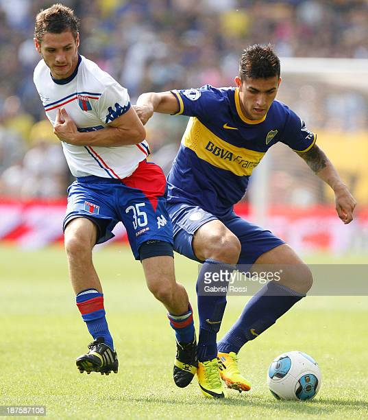 Leandro Paredes of Boca Juniors fights for the ball with Joaquin Azura of Tigre during a match between Boca Juniors and Tigre as part of round 15th...