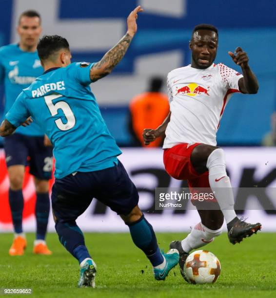 Leandro Paredes of FC Zenit Saint Petersburg and Naby Keita of RB Leipzig vie for the ball during the UEFA Europa League Round of 16 second leg match...