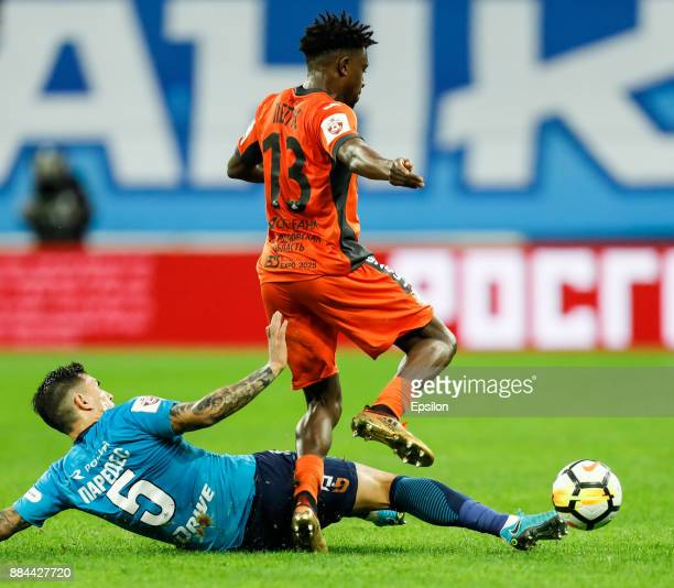 Leandro Paredes of FC Zenit Saint Petersburg and Petrus Boumal of FC Ural Ekaterinburg vie for the ball during the Russian Football League match...