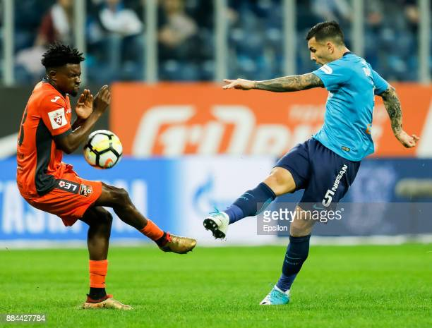 Leandro Paredes of FC Zenit Saint Petersburg shoots on goal as Petrus Boumal of FC Ural Ekaterinburg defends during the Russian Football League match...