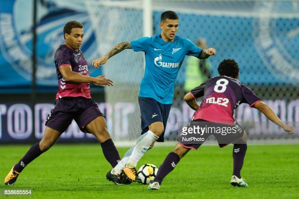 Leandro Paredes of FC Zenit Saint Petersburg vies for the ball with Cyriel Dessers of FC Utrecht and Yassin Ayoub of FC Utrecht during the UEFA...