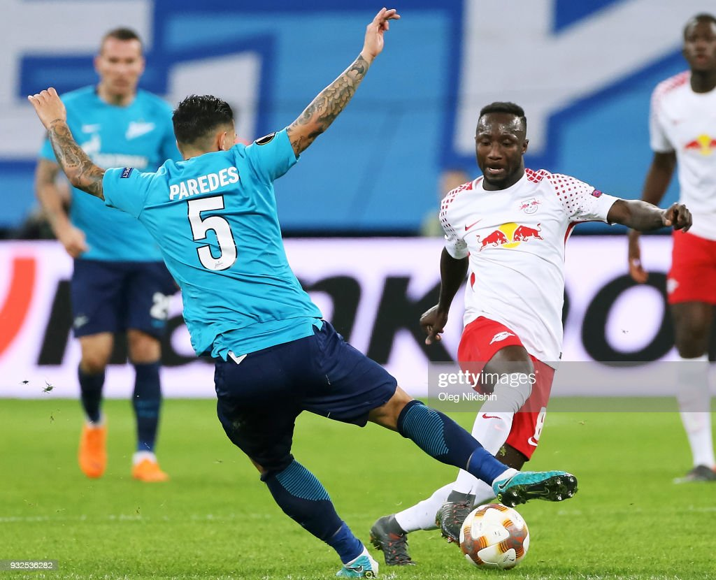 Leandro Paredes of FC Zenit vies for the ball with Naby Keita of RB Leipzig during UEFA Europa League Round of 16 match between Zenit St Petersburg and RB Leipzig at the on March 15, 2018 in Saint Petersburg, Russia.