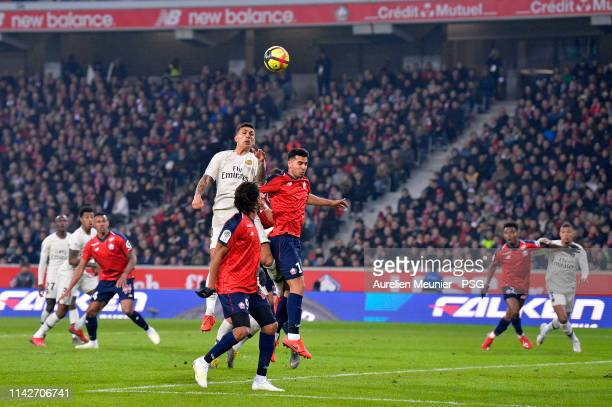Leandro Paredes of Paris SaintGermain jumps for the ball during the Ligue 1 match between Paris SaintGermain and Lille OSC at Stade Pierre Mauroy on...