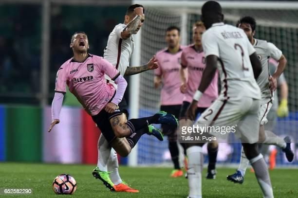 Leandro Paredes of Roma fouls Alessandro Diamanti of Palermo during the Serie A match between US Citta di Palermo and AS Roma at Stadio Renzo Barbera...