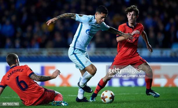 Leandro Paredes of Zenit St Petersburg duels for the ball with Alvaro Odriozola of Real Sociedad during the UEFA Europa League group L football match...