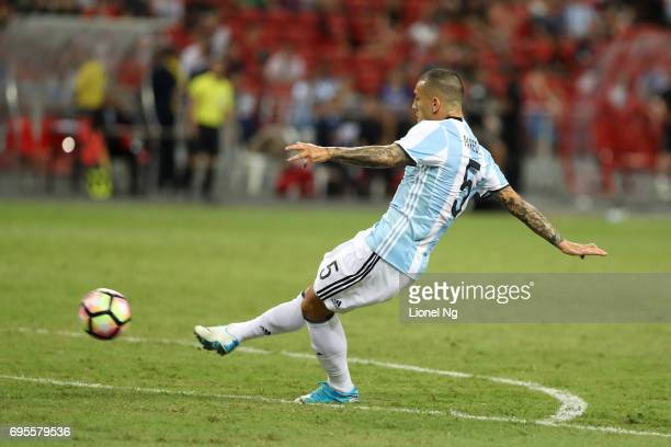 Leandro Paredes scores the fourth goal for Argentina during the international friendly match between Argentina and Singapore at National Stadium on...