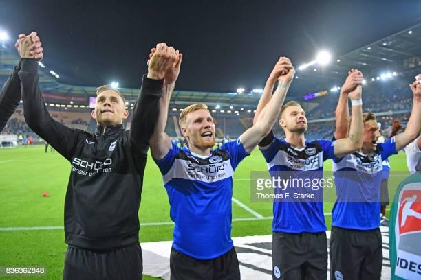 Leandro Putaro Andreas Voglsammer Florian Hartherz and Konstantin Kerschbaumer of Bielefeld celebrate after winning the Second Bundesliga match...