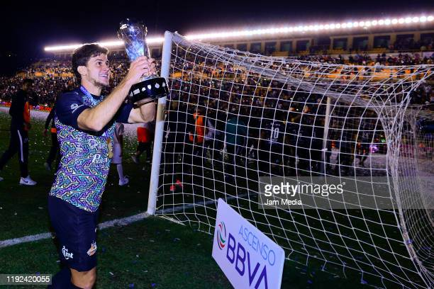 Leandro Rodriguez of Alebrijes celebrates with the trophy after the Final second leg match between Alebrijes de Oaxaca and Zacatepec as part of the...