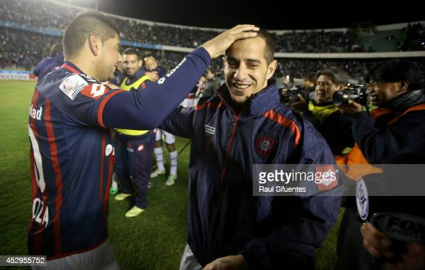 Leandro Romagnoli and Nestor Ortigoza of San Lorenzo celebrate advancing to the final after a second leg semifinal match between Bolivar and San...
