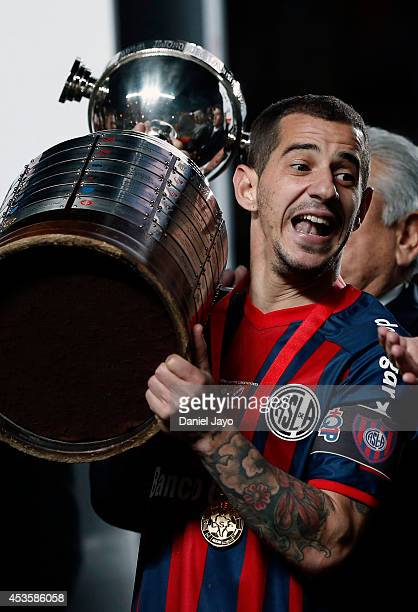 Leandro Romagnoli of San Lorenzo celebrates with the trophy at the end of the second leg final match between San Lorenzo and Nacional as part of Copa...