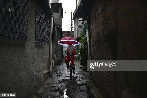 Leandro Souza who lives in the favela da Mare complex one of the most violents in Rio de Janeiro dresses as Santa Claus to distribute gifts to the...