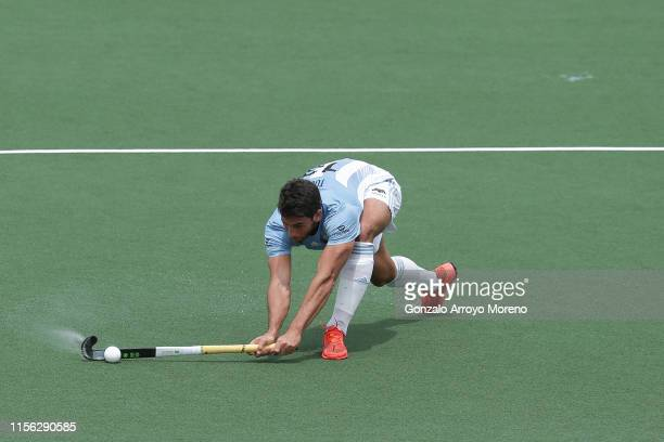 Leandro Tolini of Argentina hits the ball during the Men's FIH Field Hockey Pro League match between Spain and Argentina at Club Villa de Madrid on...